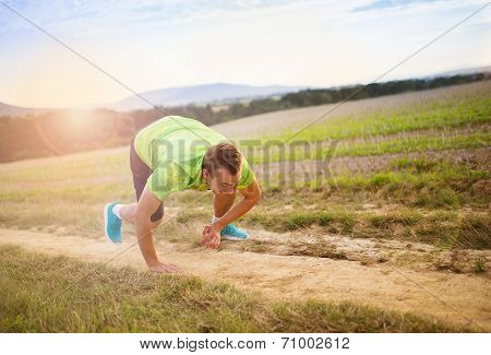Male runner tripping over
