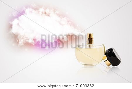 women's perfume in beautiful bottle spraying colorful cloud, copyspace in cloud
