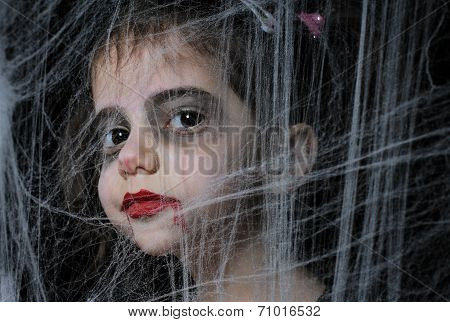 A girl with Halloween vampire make up