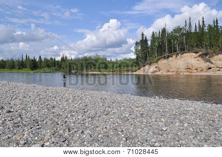 Pebble Beach North Of The River And Fisherman.