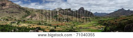 Panorama of the green valley with rice fields and villages among mountains. Anja reserve, Madagascar