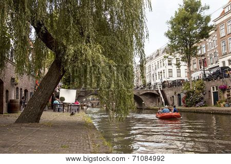 Boat And People Eating Outside At Oude Gracht In Utrecht