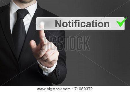 Businessman Pushing Button Notification