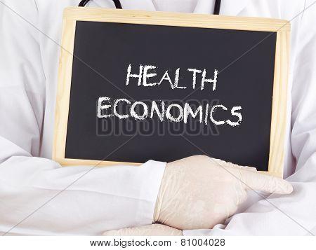 Doctor Shows Information On Blackboard: Health Economics