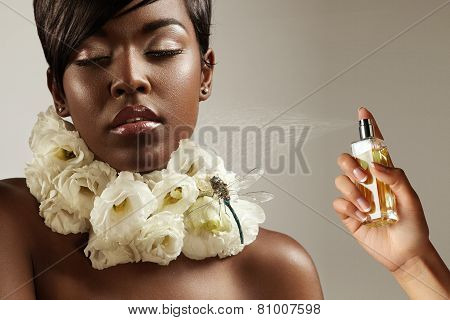 Beauty Black Woman With Flowers On Her Neck