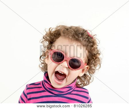 Positive child with retro sunglasses showing her happines poster