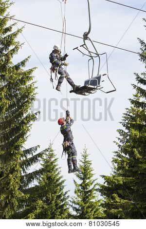 Training of rescue teams on a chairlift at ski resort Klinovec
