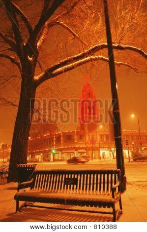 snowfall on the plaza, Kansas City, Mo. with the plaza lights, and bench
