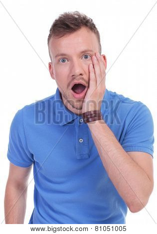 picture of a young casual man with a shocked expression on his face. isolated on a white background