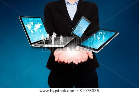Businesswoman holds laptop, phone, tablet in hands - Stock Image