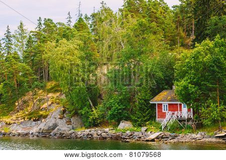 Red Finnish Wooden Bath Sauna Log Cabin On Island In Summer