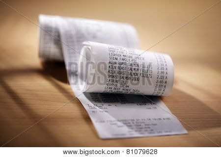 Grocery shopping list till roll printout on a wooden table