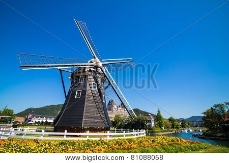 Windmill at Huis Ten Bosch stand in a bright and clear sky Japan poster