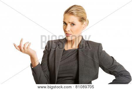 Confused woman showing irritate gesture.
