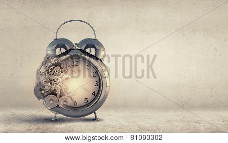 Close up of alarm clock and cogwheel mechanism poster