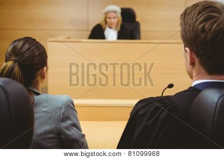Judge talking with lawyers to make a decision in the court room