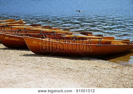 Rowboats On The Shore Of A Lake