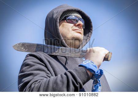 Man with machete on shoulder