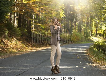 Young Woman In Autumn Staying On Street