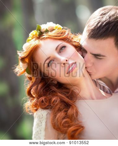 Closeup portrait of beautiful gentle loving couple, happy handsome groom kissing his lovely bride neck, love and romance concept poster
