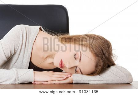 Tired woman slepping on desk.