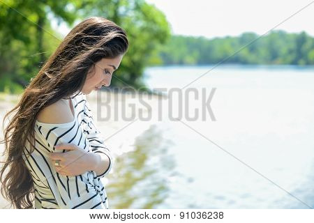 pretty girl on the beach look at water