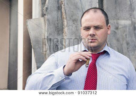 Man At Construction Site Smoking A Cigar