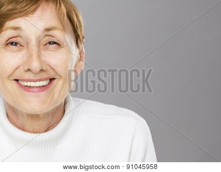 Self confident senior woman smiling