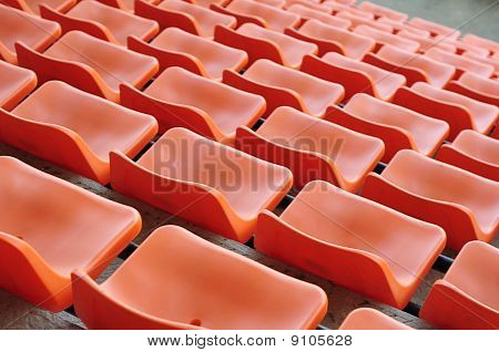 orange chair seats in an empty Stadium Seats , stand