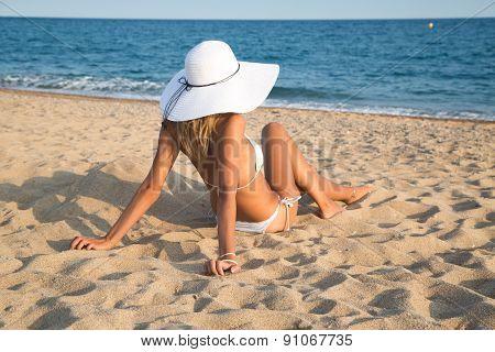 Beautiful Girl Lying On The Beach .