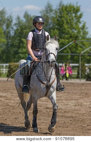 Young Horsewoman On The White Horse