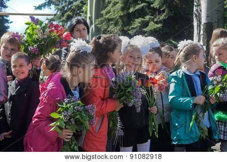 Makeevka, Ukraine - May, 7, 2014: Children Congratulate Veterans Of World War Ii On The Anniversary