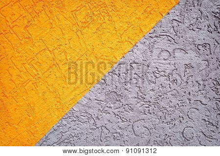 Grey and orange concrete wall texture