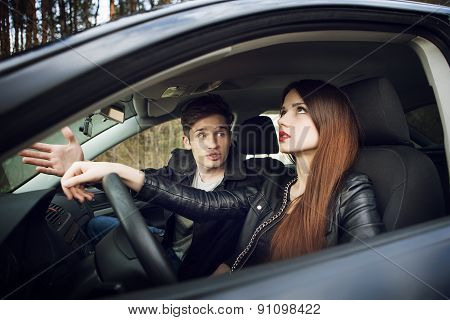 couple quarrel in the car,  woman behind wheel of  car