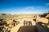 Tourist's shadows in Chaco Culture National Historical Park New Mexico USA poster