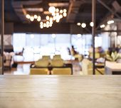 Table top counter Bar with Blurred Cafe Restaurant Interior background poster