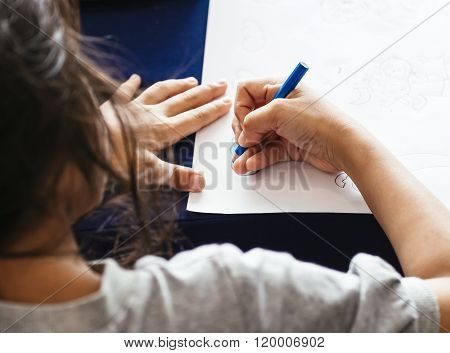 Kid Drawing Hand With Colour Pencil And Paper On Table Art Education Background