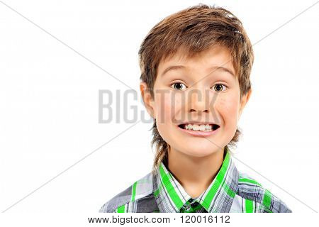 A boy looks at the camera and smiling sugary. Studio shot. Isolated over white.