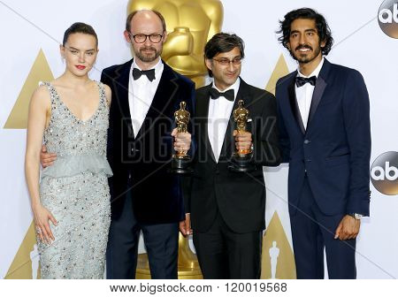 James Gay-Rees, Asif Kapadia, Dev Patel and Daisy Ridley at the 88th Annual Academy Awards - Press Room held at the Loews Hollywood Hotel in Hollywood, USA on February 28, 2016.