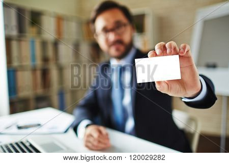 Close-up of businessman holding a blank card