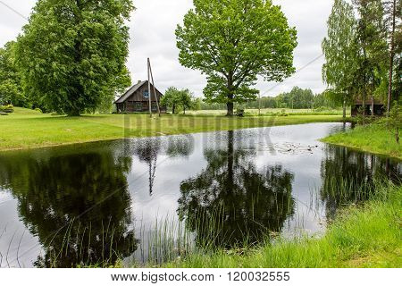 Country House With Pond And Oak Trees With Pond
