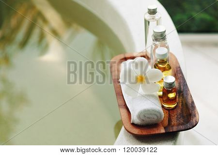Spa decoration, natural organic bath products on a wooden tray in the bathroom
