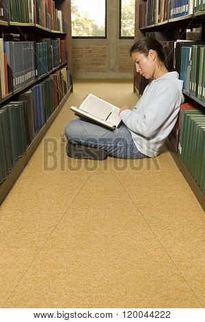 Female student reading in the library