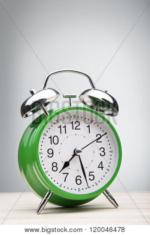 classic green alarm clock morning wake-up time