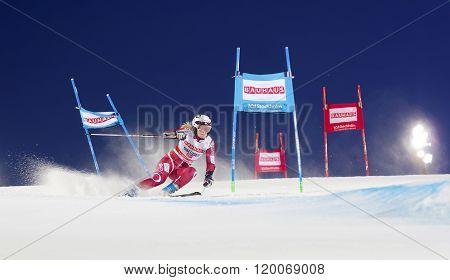 Skier Nina Loeseth Skiing At A Slalom Event