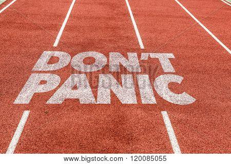 Don't Panic written on running track