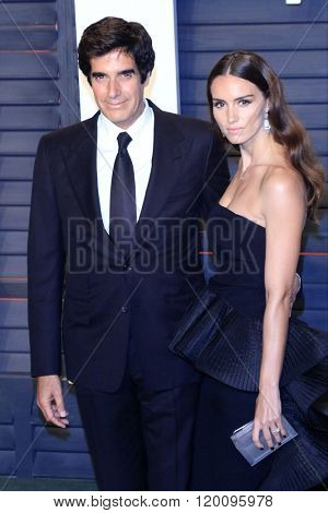 BEVERLY HILLS - FEB 28: David Copperfield, Chloe Gosselin at the 2016 Vanity Fair Oscar Party on February 28, 2016 in Beverly Hills, California