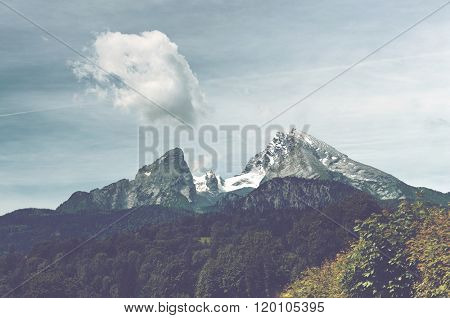 Blue Sky and Lush Green Forest Surrounding Watzmann Mountain within Borders of Berchtesgaden National Park, Bavarian Alps, Germany