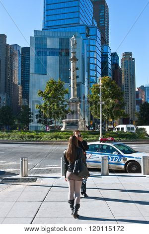 New York, U.S.A. - October 10, 2010: Manhattan people and photographs in Columbus Circle