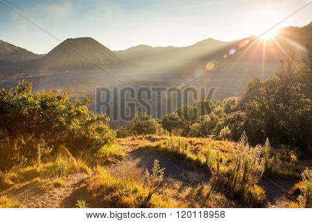 Before Sunset With Sun-flare At Mount Bromo Volcano, The Magnificent View Of Mt. Bromo Located In Br